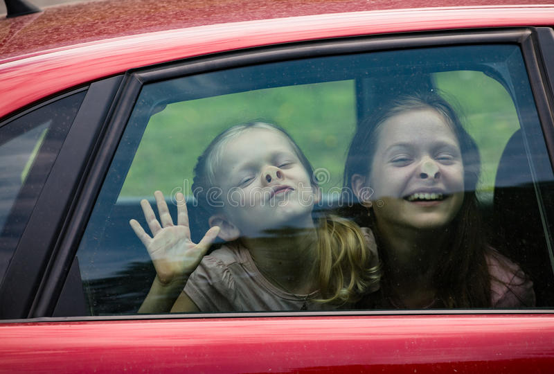 Children making funny faces stock photos