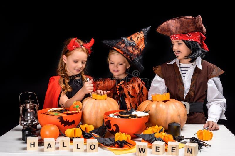 Children making halloween jack o lanterns stock image