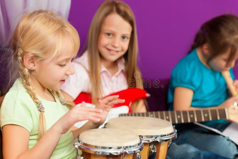 Children making music stock image