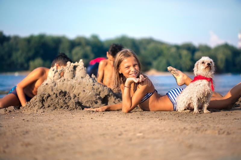 Children making sand castle at tropical beach. Happy children playing on the beach stock image