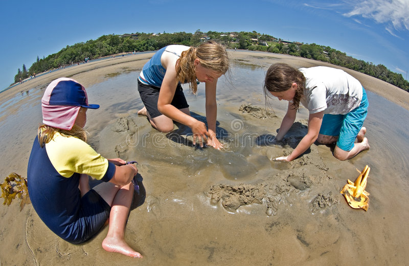 children making sand castles royalty free stock images