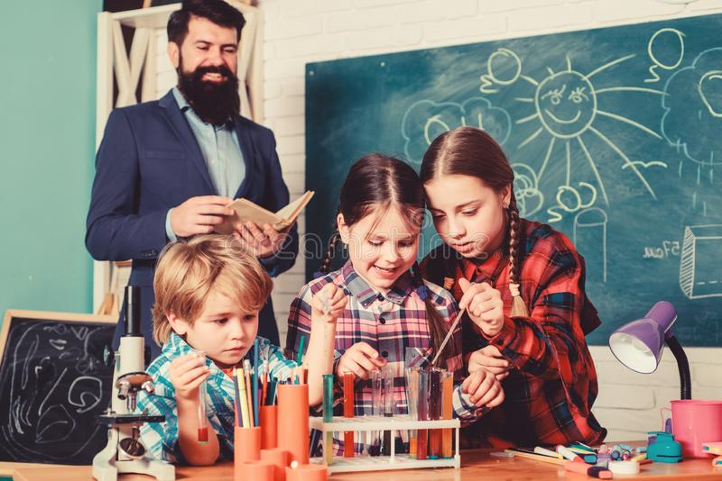 Children making science experiments. Education. Science and education. chemistry lab. happy children teacher. back to stock photography