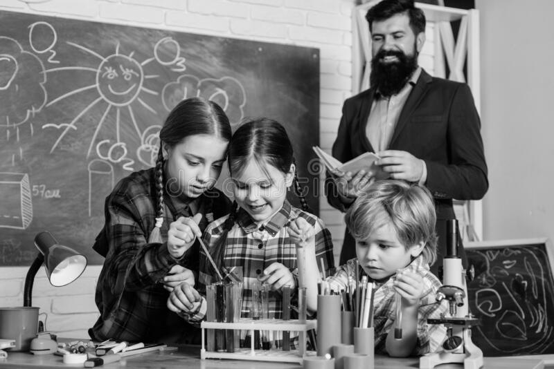 Children making science experiments. Education. Science and education. chemistry lab. happy children teacher. back to royalty free stock photography