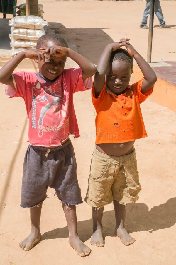 Children in Malawi. Kasungu, Malawi - March 27, 2015: Local children in small village near Kasungu in Malawi stock image