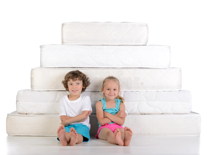 Children and many mattresses royalty free stock photo