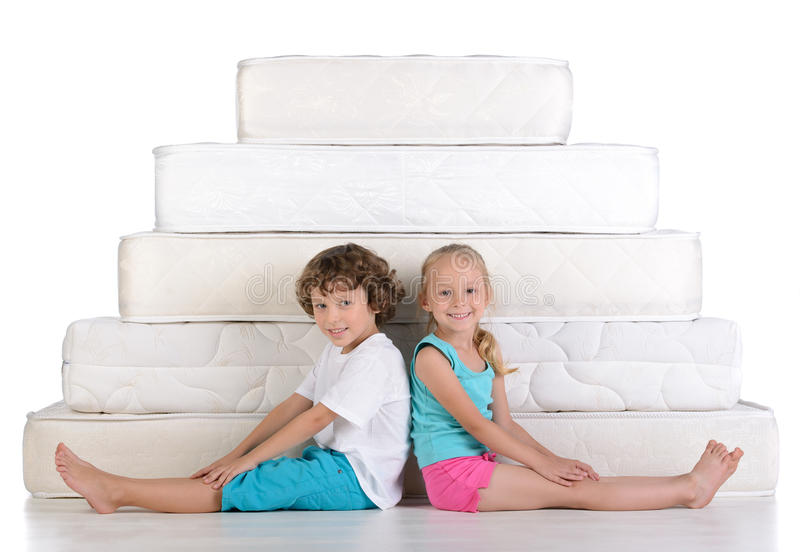 Children and many mattresses royalty free stock images