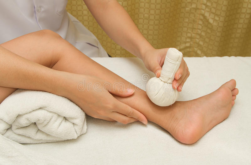Download Children Massage With Herbal Compress Balls Stock Image - Image: 32453027