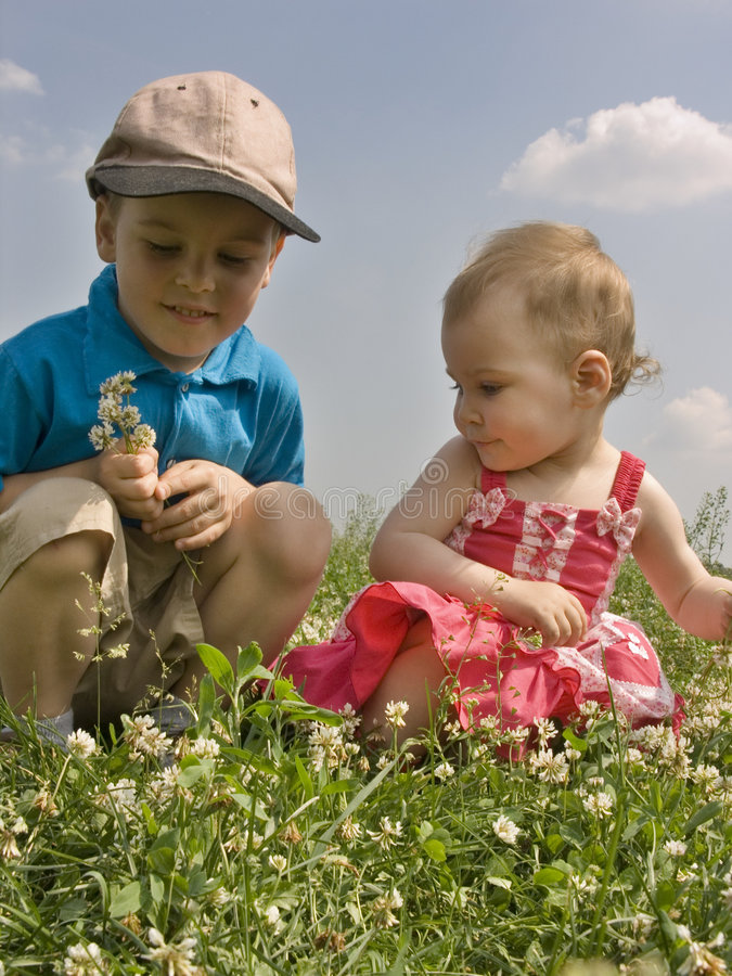 Children on meadow 2 royalty free stock photos
