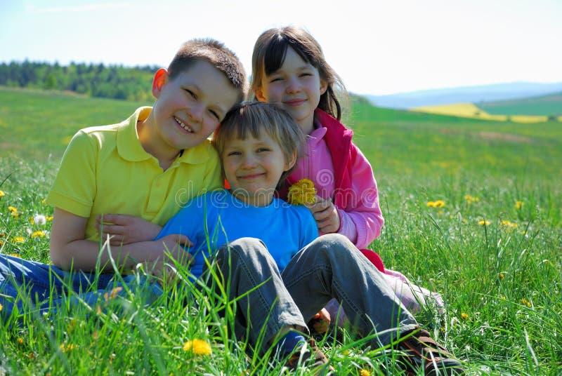 Children in Meadow stock photos