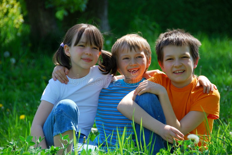 Children in meadow royalty free stock image