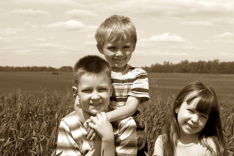 Children on meadow stock photography