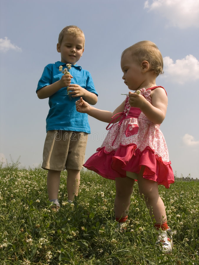 Children on meadow royalty free stock photos