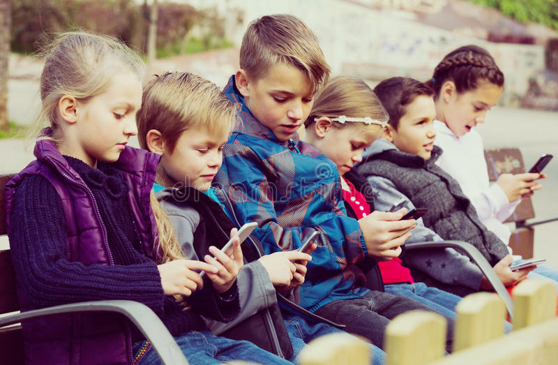 Children with mobile devices stock photos