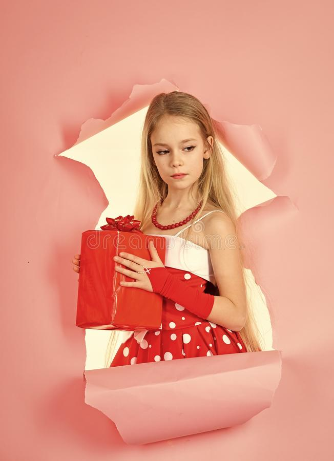 Children model. Child girl with present pack, cyber monday. child girl hold gift box, copy space. stock photo