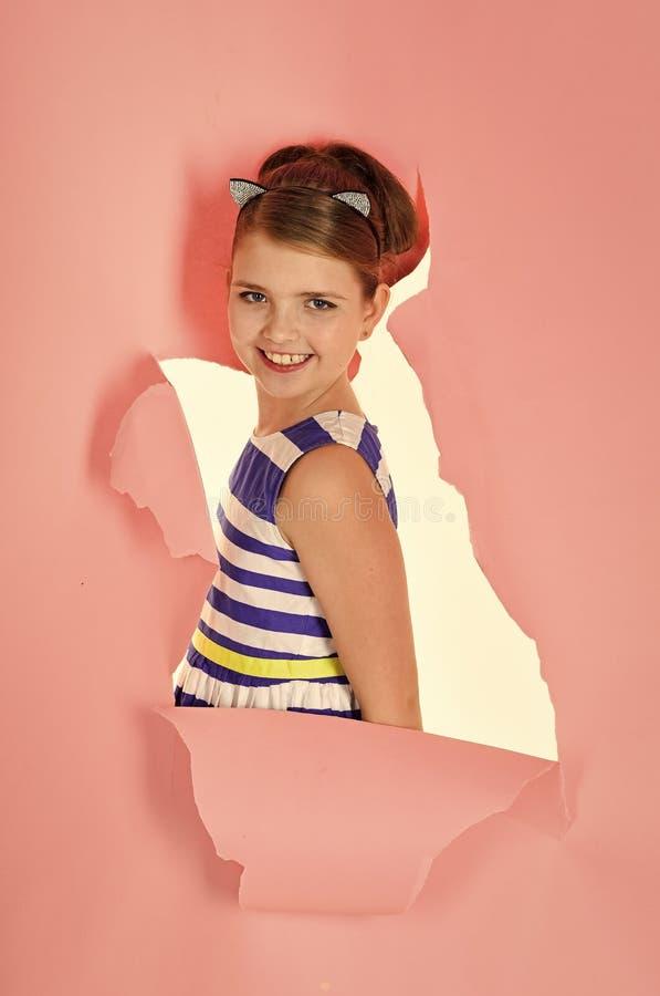 Children model. Child girl in stylish glamour elegant dress. child girl has beautiful hair royalty free stock photo