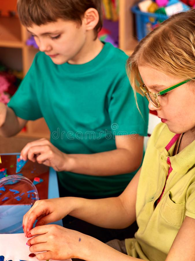 Children model from plasticine in school craft lesson stock photos