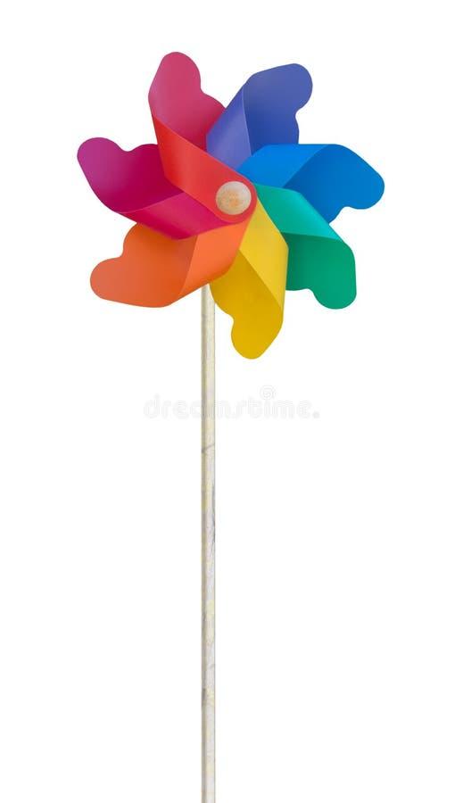 Children& x27; moinho de vento plástico do brinquedo de s, isolado no branco fotografia de stock