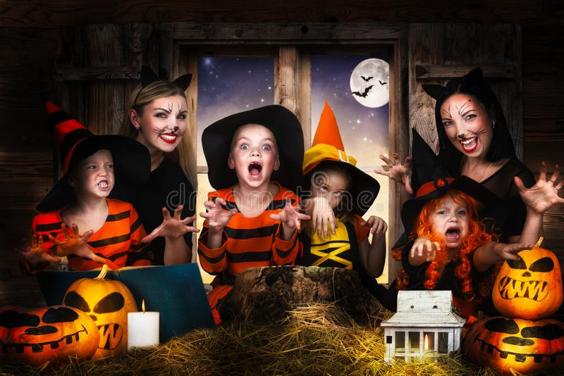 Children with moms celebrating Halloween. royalty free stock photos