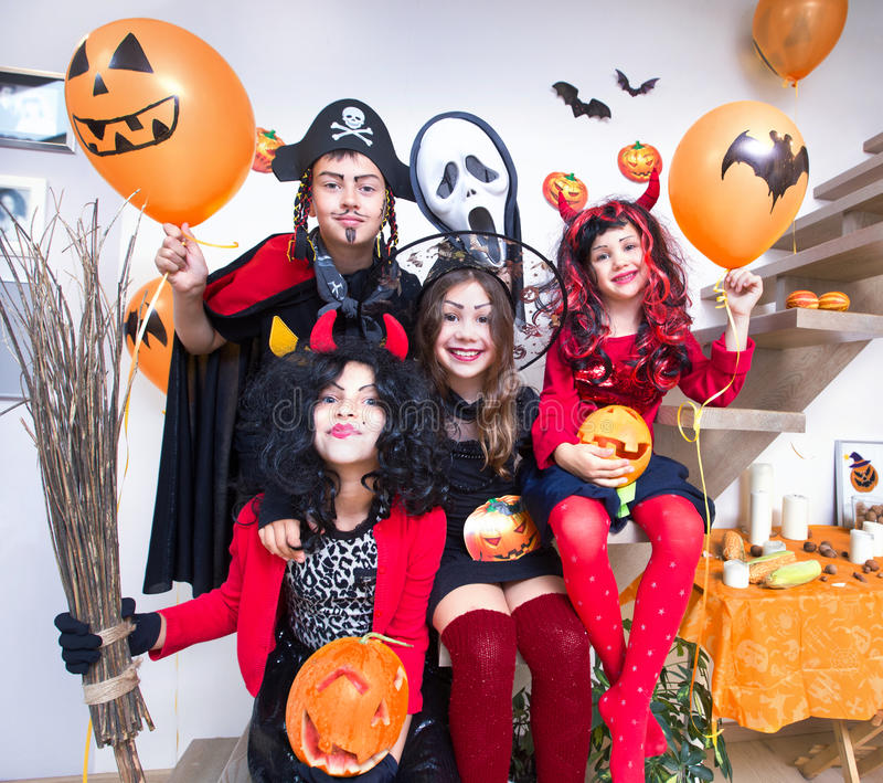 Kids in halloween costumes. Children in monster costumes have fun on a Halloween holiday stock images