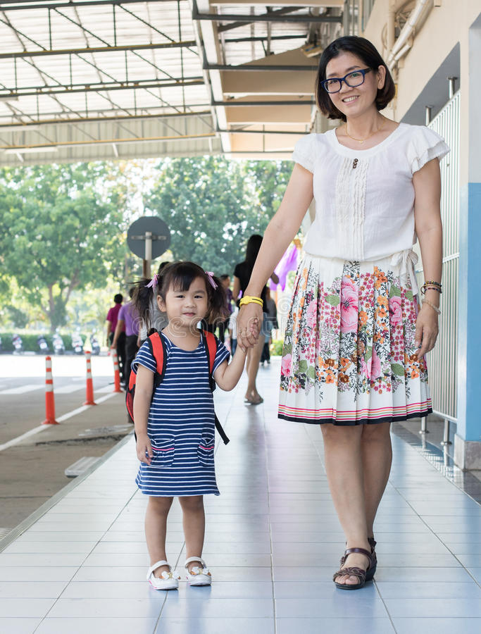 children and mother go to school first day use for education ,kid in kindergarten royalty free stock photo