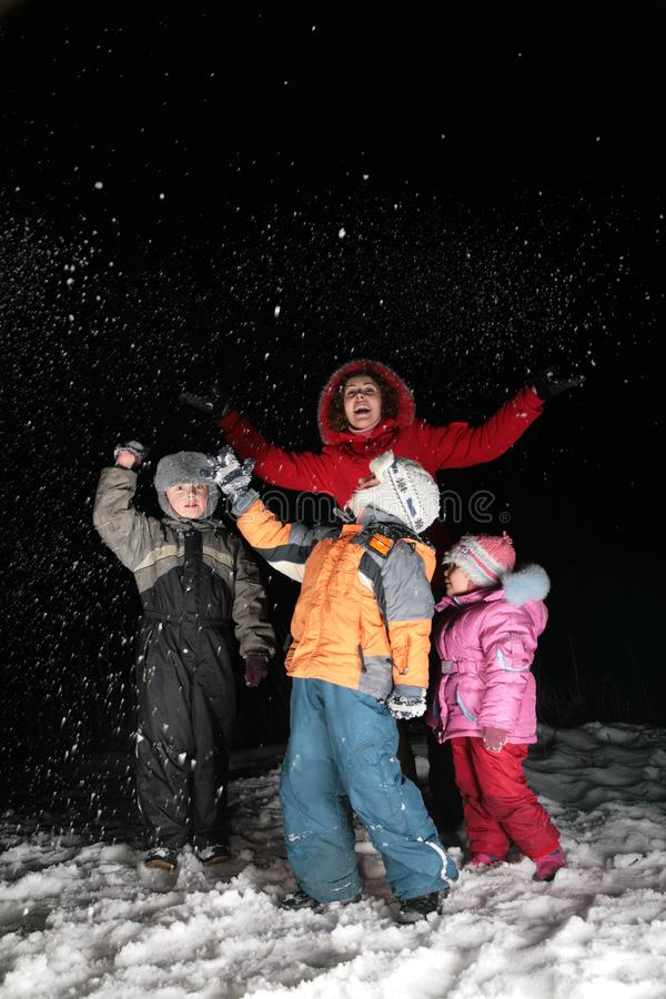 Download Children And Mother Throw Snow In Night Stock Image - Image: 4485651