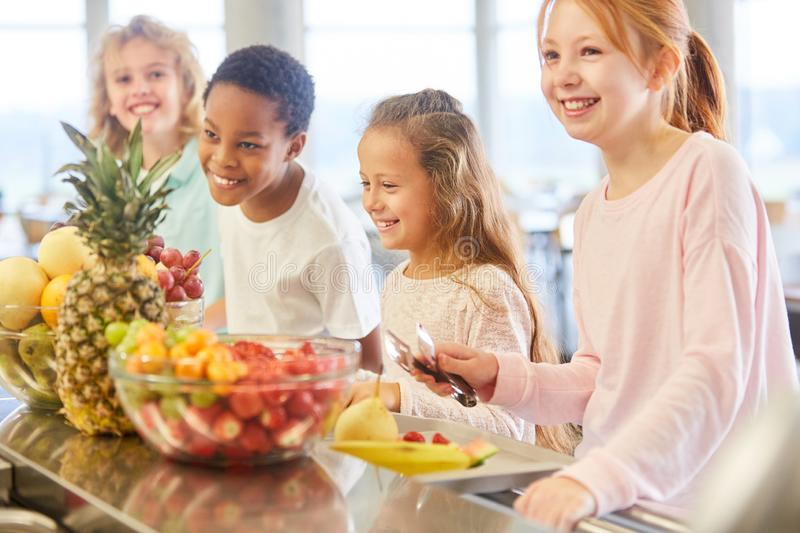 Children take healthy fruit royalty free stock images