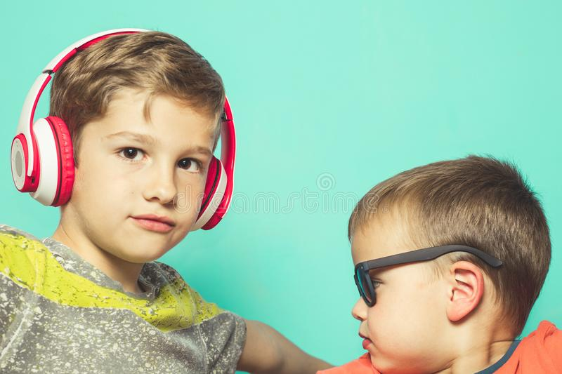 Children with music helmets and sunglasses. With a fun attitude stock image