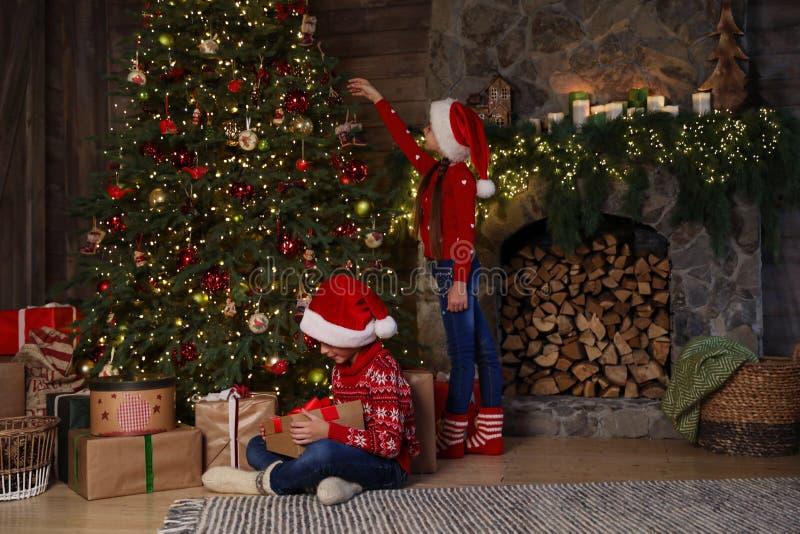 Children near beautiful Christmas tree royalty free stock image
