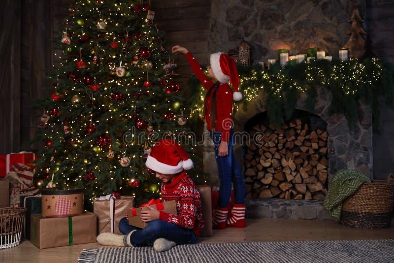 Children near beautiful Christmas tree stock image