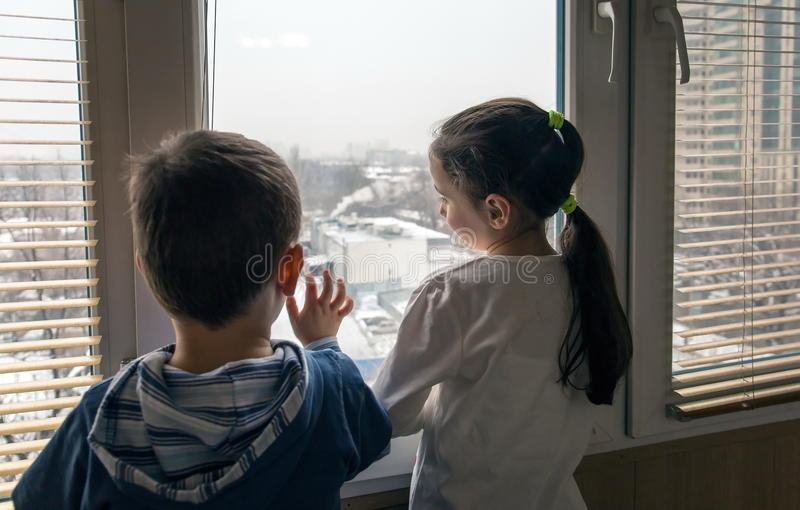 Children near a window. stock image