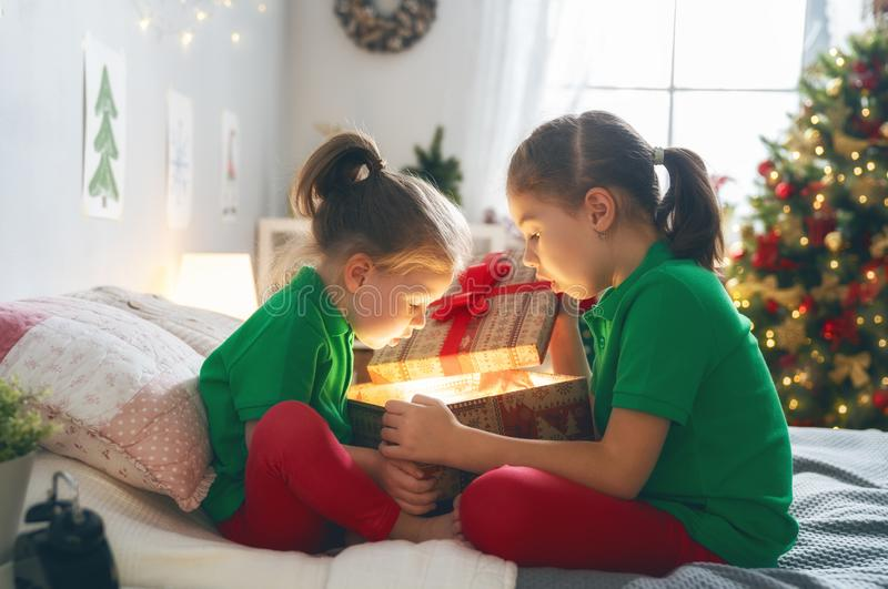 Children opening Christmas presents royalty free stock images