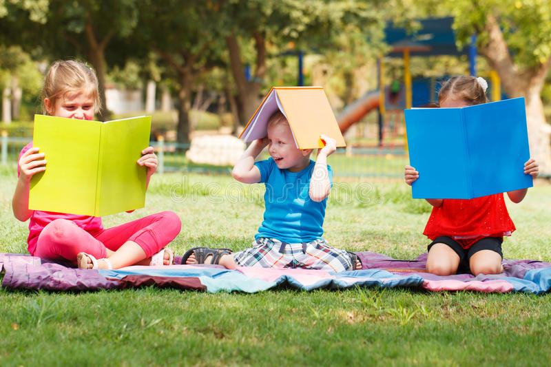 Download Children outdoors stock image. Image of girls, book, front - 33476561
