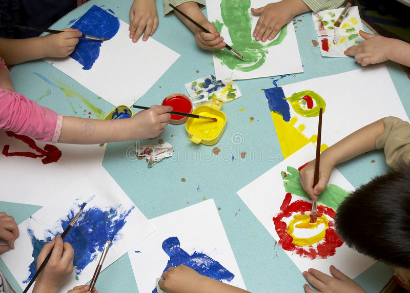 Children painting stock photos