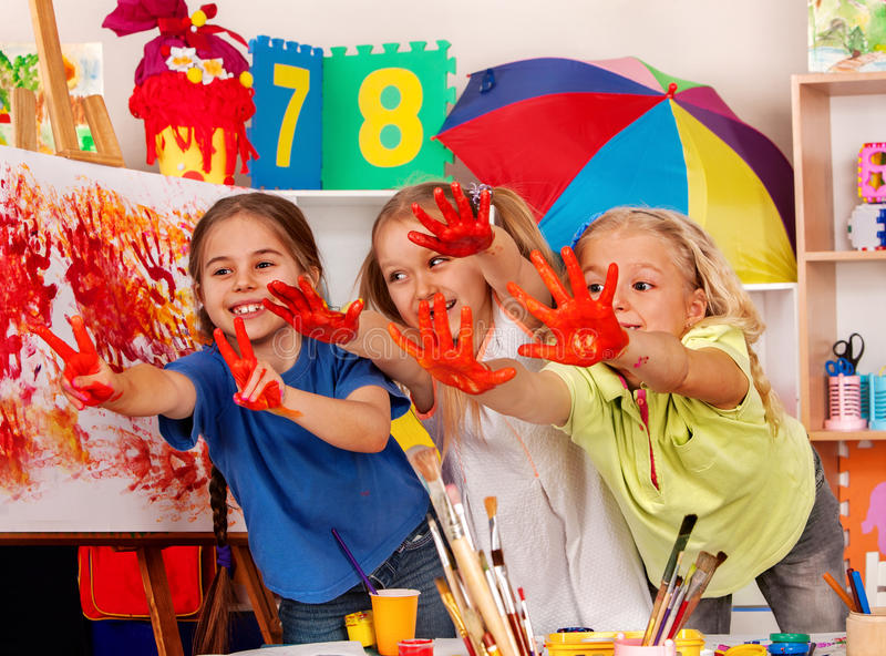 Children painting finger on easel. Small students in art school class. Cheers children in kindergarten. Craft drawing education develops creative abilities of royalty free stock images