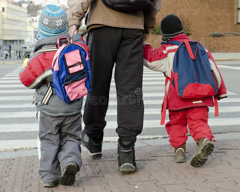 Children a parent crossing road stock photo