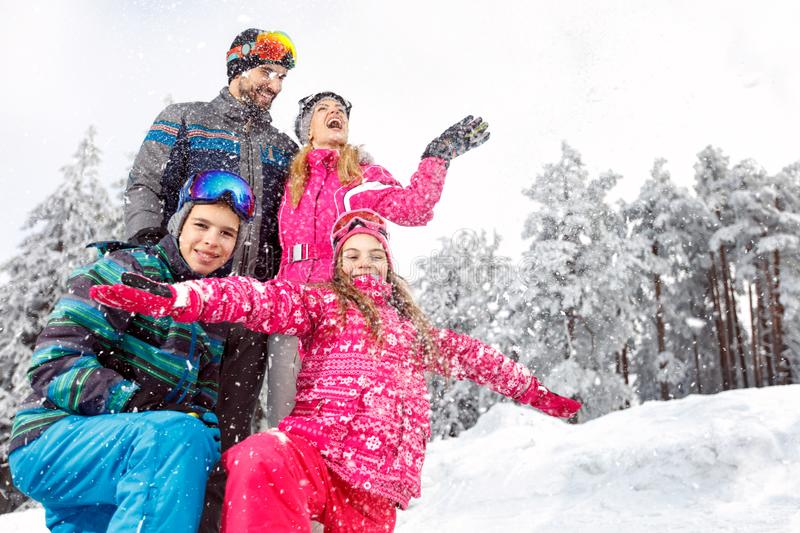 Children with parents in snowy nature at winter vacation stock image