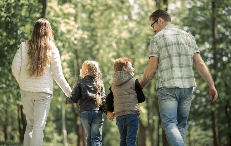 Children and parents on a walk in the Park.t royalty free stock images