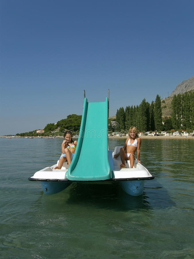 Download Children On Pedal Boat At Sea 2 Stock Image - Image: 25559645