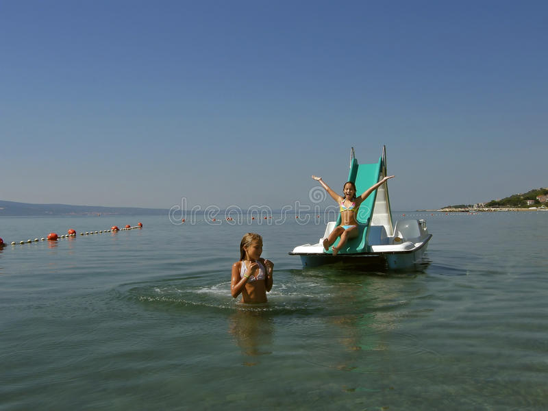 Children on pedal boat at sea 5 stock photography