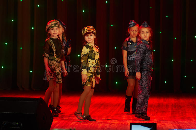 Children perform in The 'New Style' music and art festival. MINSK-BELARUS, OCTOBER 15: unidentified children perform in The 'New Style' music and art festival stock photo
