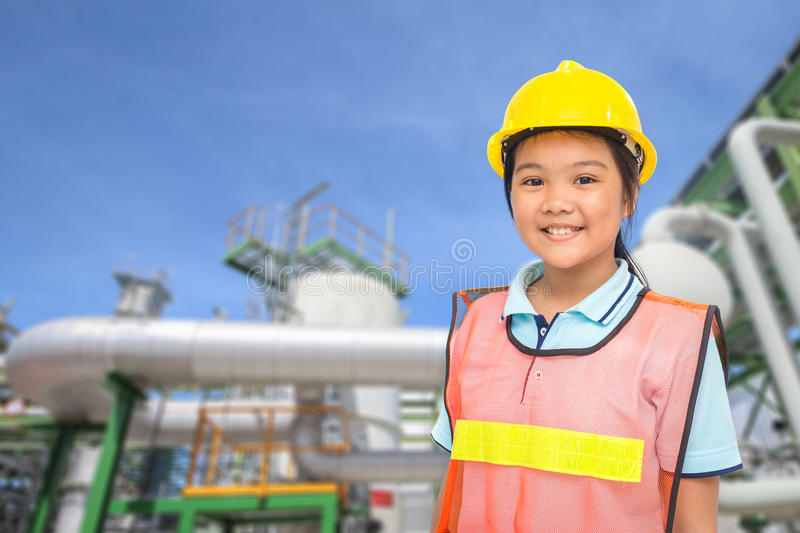 Children with Petroleum plant background royalty free stock photos