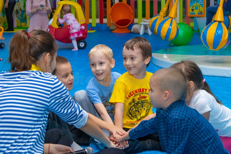 Children play with the animator in the entertainment center. Cheboksary, Russia, 10/20/2018. Children play with the animator in the entertainment center stock photography