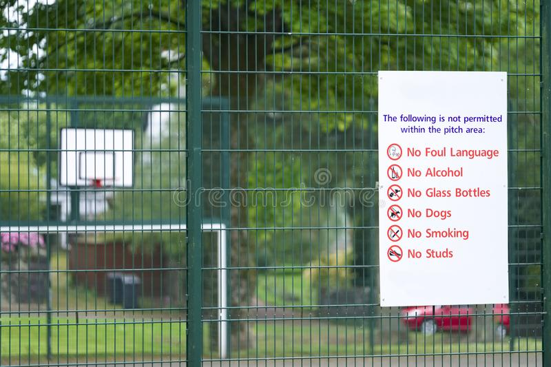 Children play area rules sign no foul language  alcohol dogs or smoking allowed stock photography