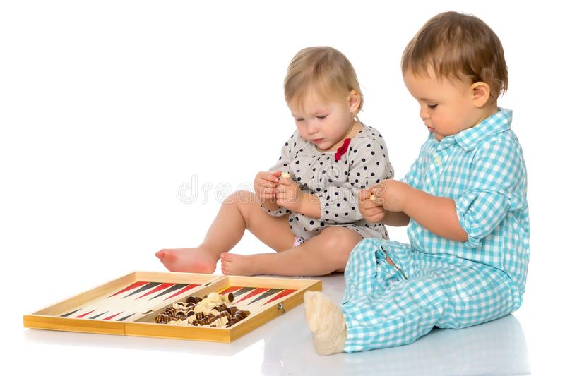 Children play chess and backgammon. royalty free stock images