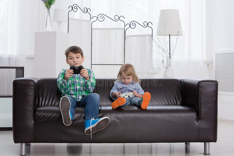 Children play in the console home stock photos
