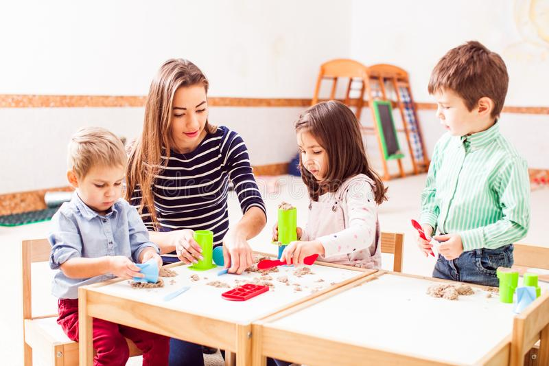 Children play with kinetic sand royalty free stock photo