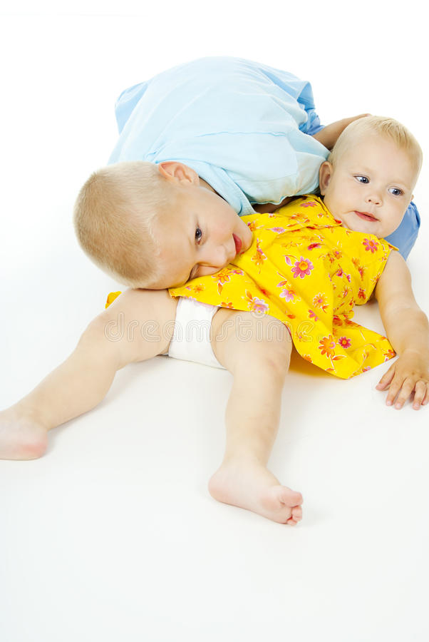 Download Children Play While Lying On The Floor Stock Photo - Image: 26079706