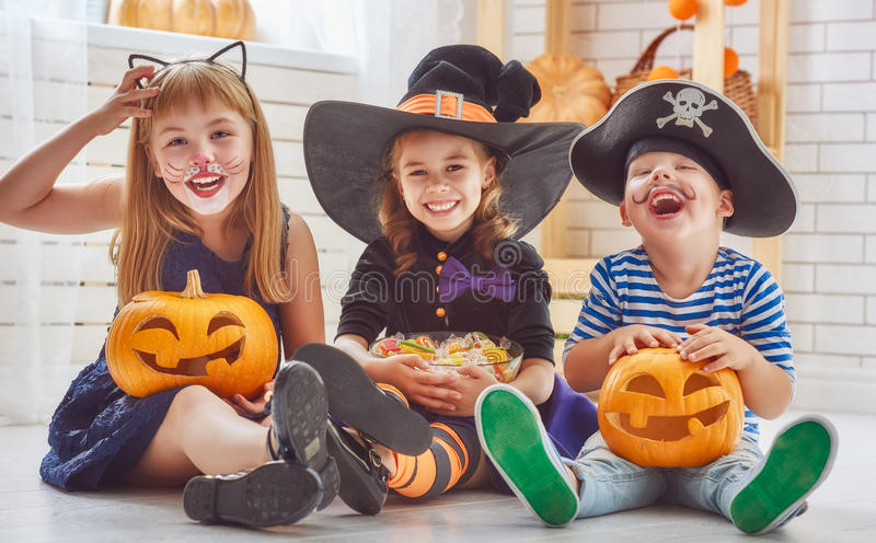 Children play with pumpkins royalty free stock photo