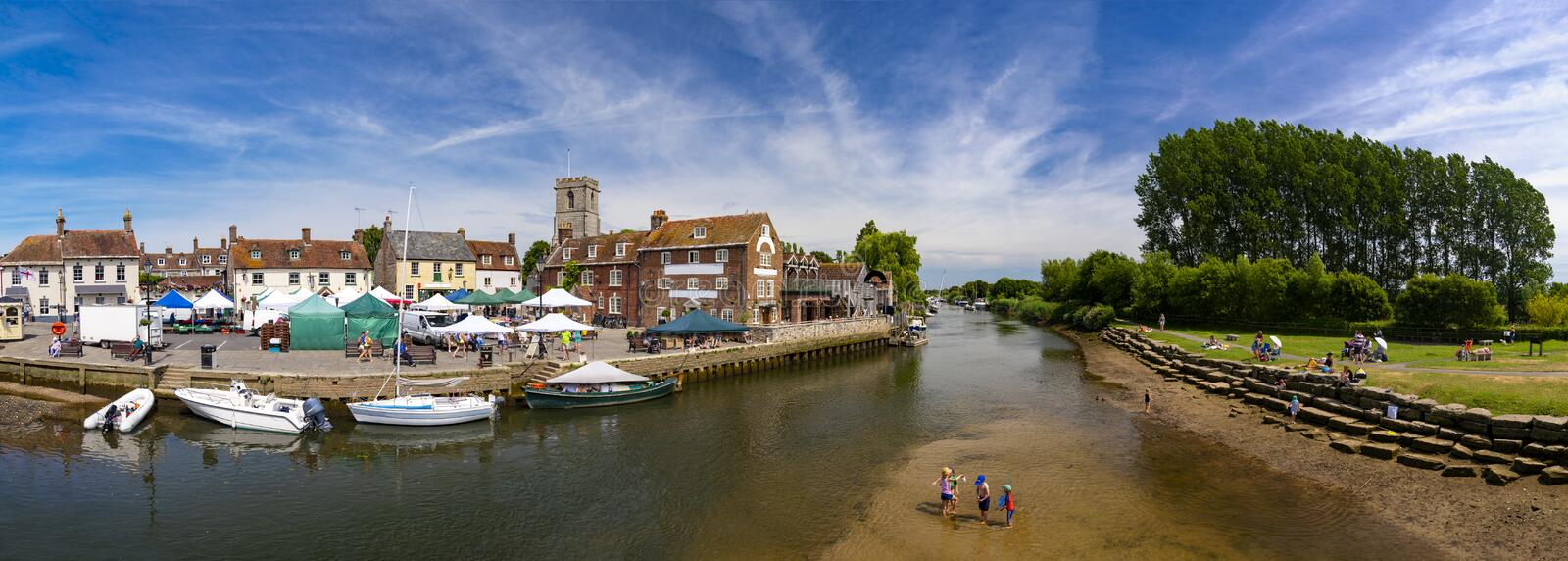 Children play in the river Frome at Wareham. Low tide at Wareham Quay with children playing in the water royalty free stock photos