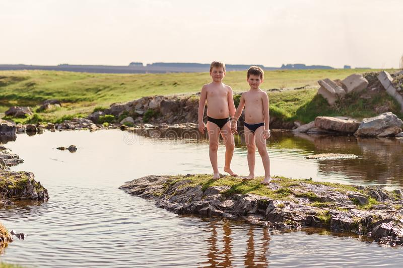 children play on the river in summer stock images